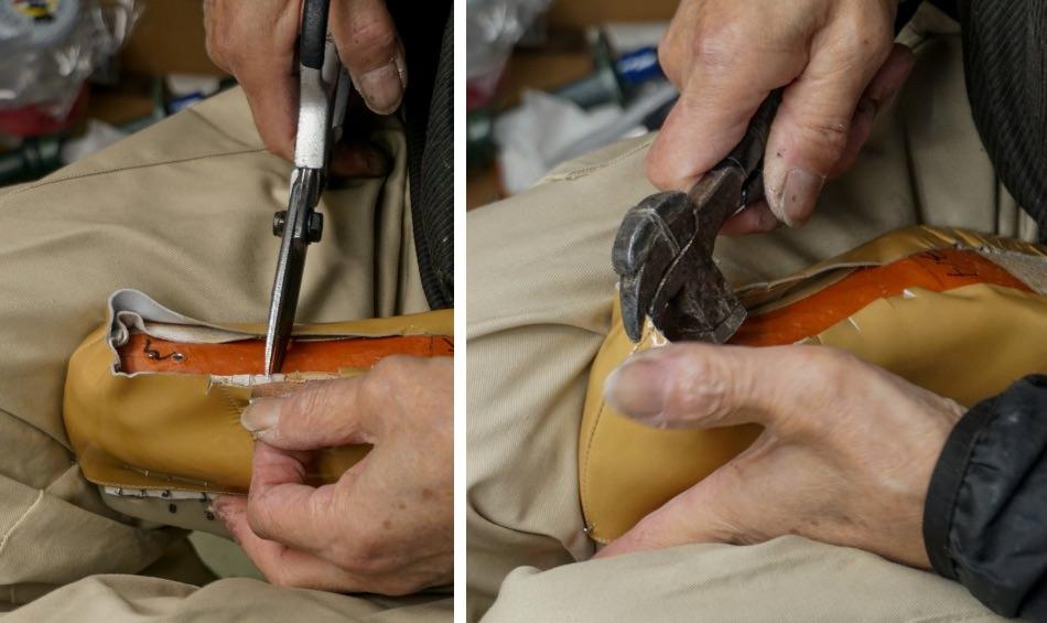 写真:革やカウンターにハサミを入れながら、靴の側面をつり込む様子。